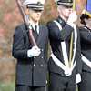 Boston Consortion Navy ROTC Color Guard members Francis Davis, left, and Eric Klatt, right, stand at attention during a dedication ceremony on Sunday morning for fallen soldiers on Monumet Ave in Swampscott. David Le/Staff Photo
