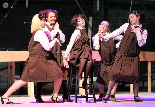 """From left: Salem State University students Emily Reardon, Caitlyn Jones, Michelle Faria, Katy Walthall, and Tina Barry, rehearse a scene from the musical """"Cabaret,"""" which will be playing in the Salem State Mainstage Auditorium from November 29th through December 9th. David Le/Staff Photo"""