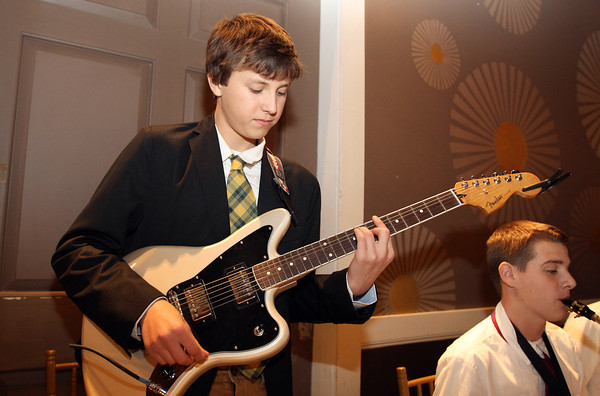 Freshman Will Schmidt of the Hamilton-Wenham Jazz Combo plays a guitar solo at the North Shore Chamber of Commerce Annual Dinner at the Danversport Yacht Club on Wednesday evening. David Le/Staff Photo