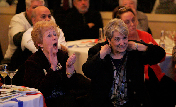 Peabody:<br /> Jane Dean of Danvers, left, and Angela Doucot of Rowley, react to the returns posted on the large screen TV at Richard Tisei's party held at the Peabody Marriott early in the night.<br /> Photo by Ken Yuszkus.
