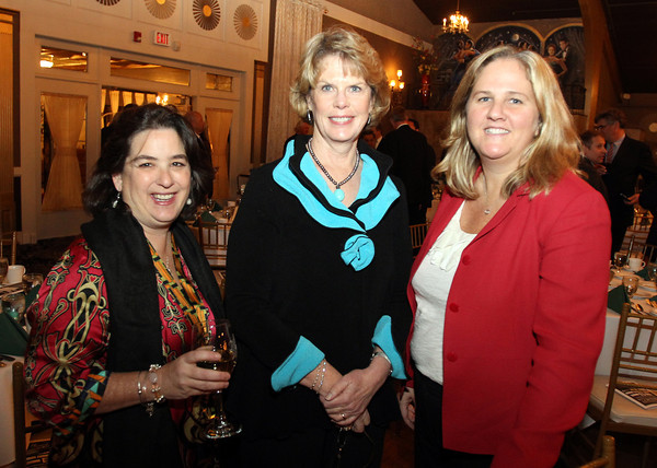 From left, Darlene Hayes, Chief Director for the Boston Lobsters, and Nancy Mobley and Michele St. Larent, of Insight, at the North Shore Chamber of Commerce Annual Dinner at the Danversport Yacht Club on Wednesday evening. David Le/Staff Photo
