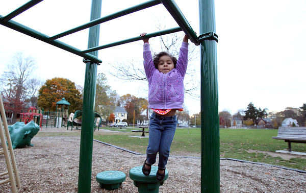 Soleil Nelson, 3, of Beverly, swings on the monkey bars at Kimball Haskell Park on Thursday afternoon. David Le/Staff Photo