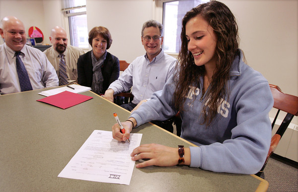 Ipswich:<br /> From left, principal Dave Dalton, AD Tom Gallagher, Natalie Soliozy's parents, Patty and Stephen Soliozy, watch Natalie Soliozy sign her national letter of intent to play lacrosse at Division 1 Johns Hopkins University. Natalie Soliozy is an Ipswich High School senior lacrosse player.  <br /> Photo by Ken Yuszkus/The Salem News, Monday, November 19, 2012.
