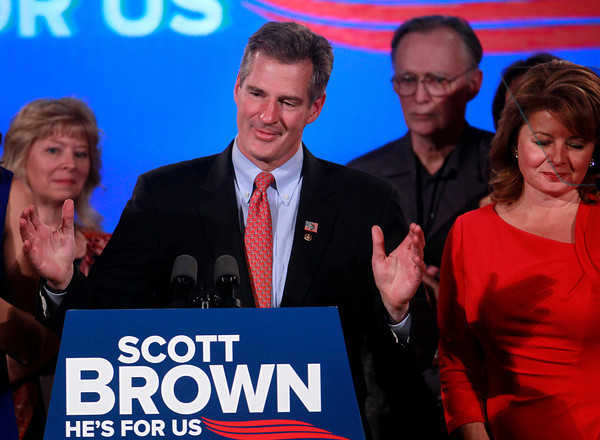 U.S. Sen. Scott Brown, R-Mass., center left, gives a concession speech as his wife Gail Huff, right, watches on at an election night watch party in a hotel in Boston, Tuesday, Nov. 6, 2012. Brown lost to Democratic challenger Elizabeth Warren in his bid for re-election to the U.S. Senate. (AP Photo/Steven Senne)