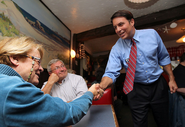 US Congress candidate Richard Tisei, right, greets Judi and Alex Mulholland, left, of Ipswich while campaigning at The Clam Box on Thursday afternoon. David Le/Staff Photo