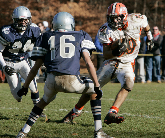 Hamilton:<br /> Ipswich's John Elnagger runs the ball trying to avoid Hamilton-Wenham's James Foye during the Ipswich at Hamilton-Wenham Thanksgiving football game.<br /> Photo by Ken Yuszkus/The Salem News, Thursday, November 22, 2012.