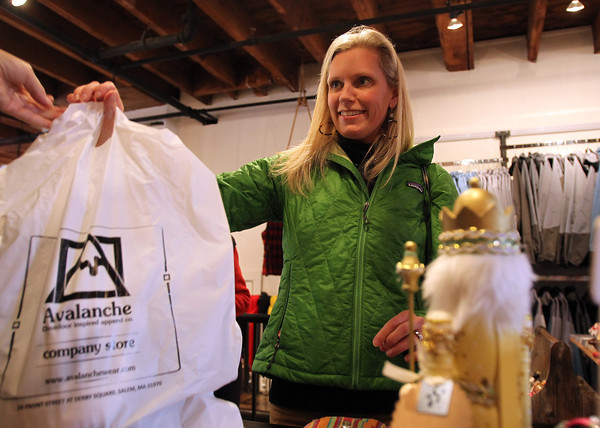 Susan Hamilton, of Marblehead, makes a purchase at Avalanche on Front St. in Salem on Friday afternoon. David Le/Staff Photo