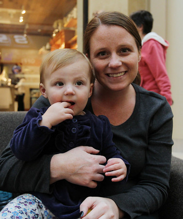 Brooke Paoli, of Lynnfield, and her daughter Davis, 1, pose for a photo in the Northshore Mall on Tuesday afternoon after talking about the upcoming Black Friday shopping craze. David Le/Staff Photo