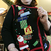 Danvers:<br /> Cathy Gareri displays her festive vest which she wore for Ugly Sweater Day at the Parade of Trees Festival.<br /> Photo by Ken Yuszkus/The Salem News, Thursday, November 29, 2012.