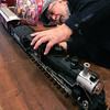 Danvers:<br /> Dick Boucher places a model locomotive on the tracks of his train display at the Parade of Trees Festival held at Tapley Memorial Hall. Incorporating his train setup he will play the role of conductor at the Polar Express Story Hour on Wednesday at 6:30.<br /> Photo by Ken Yuszkus/The Salem News, Tuesday, November 27, 2012.