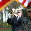 "Swampscott Band Director Scott Winship plays ""Taps"" at a memorial dedication on Monumet Ave in Swampscott on Sunday morning. David Le/Staff Photo"