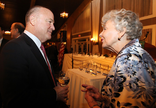Guest speaker Steve Crosby, left, talks with Joanne Patton, right, wife of General George Patton, at the North Shore Chamber of Commerce Annual Dinner at the Danversport Yacht Club on Wednesday evening. David Le/Staff Photo