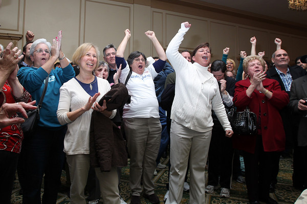 John Tierney supporters in the Ballroom at the Hawthorne Hotel in Salem erupt after the TV showed a Barack Obama victory in the Presidential Election on Tuesday evening. David Le/Staff Photo