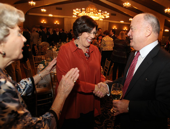 Guest speaker Steve Crosby, right, talks with Dianne Palter Gill, Dean of North Shore Community College, center, and Joanne Patton, left, of Hamilton, at the North Shore Chamber of Commerce Annual Dinner at the Danversport Yacht Club on Wednesday evening. David Le/Staff Photo