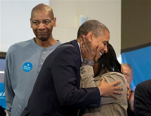 President Barack Obama is embraced by a volunteer as he visits a campaign office the morning of the 2012 election, Tuesday, Nov. 6, 2012, in Chicago. Obama has been reelected to a second term, defeating Republican challenger Mitt Romney. (AP Photo/Carolyn Kaster)