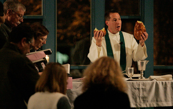 Peabody:<br /> Senior pastor, Joel Anderle conducts a communion service at the Community Covenant Church. More than 800 congregations throughout the country conducted services for people after they voted.<br /> Photo by Ken Yuszkus.
