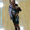Gordon College sophomore Brooke Kratche, left, and Newbury freshman Jere St. Lewis, right, battle for control of a loose ball on Friday evening in the Fighting Scots' home opener at the Bennett Athletic Center in Wenham. David Le/Staff Photo