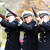 From left, Boston Consortion Navy ROTC members Michael Simpson, Angel de la Cruz, and Dan Rittenhouse fire three rounds during a ceremony to dedicate a new memorial to fallen soldiers on Monumet Ave in Swampscott. David Le/Staff Photo