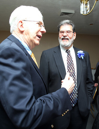 Danvers Hall of Fame inductee Len Elwin, right, chats with former coach John McGrath, left, at the induction ceremony on Tuesday evening. David Le/Staff Photo