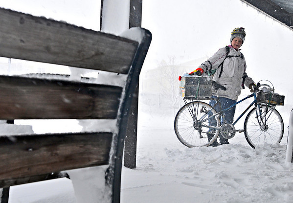 Salem: Paula Walach waits for a train in Salem on her way to work after a 25 minute bike ride in the snow storm from her home in Peabody.  She said she likes to bike no matter what and has her bike equipped with snow tires.  photo by Mark Teiwes / Salem News