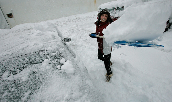 Beverly: Michelle Brooks clears around her drive way off of Water Street in Beverly. Michelle took the day off from her work in Boston. Photo by Mark Lorenz/Salem News