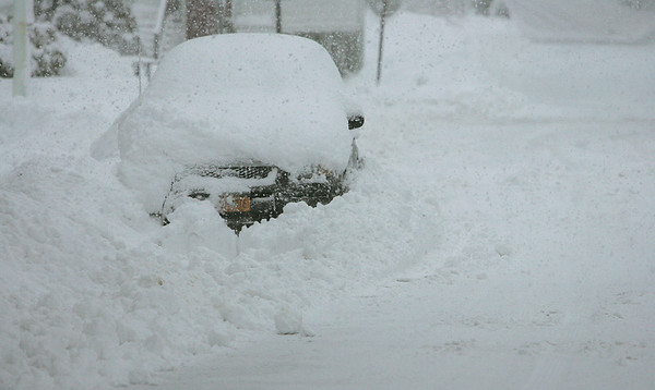 Beverly: A car is burried with Wednesday's snow fall on Knowlton Street in Beverly. Photo by Mark Lorenz/Salem News