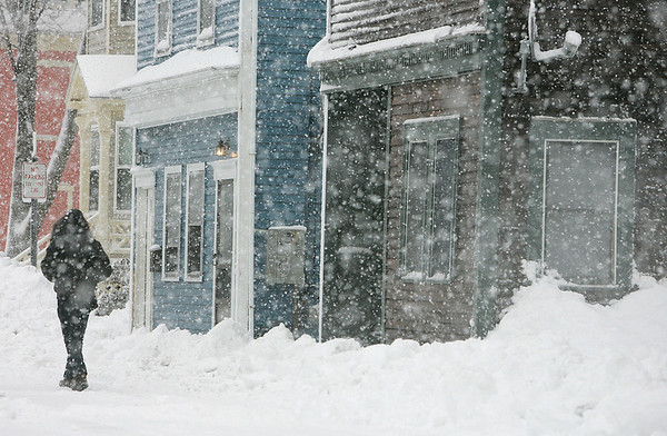 Beverly: A walker walks along Winter Street in Beverly. Photo by Mark Lorenz/Salem News