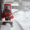 Danvers: Mike Warren uses a snowblower to clear snow from the walkway in downtown Danvers Wednesday morning. Photo by Ken Yuszkus/Salem News, Wednesday, January 13, 2011.