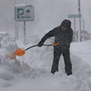 Danvers: Manny Nunes shovels snow from the walkway on Maple Street, Danvers Wednesday morning.<br /> Photo by Ken Yuszkus/Salem News, Wednesday, January 13, 2011.