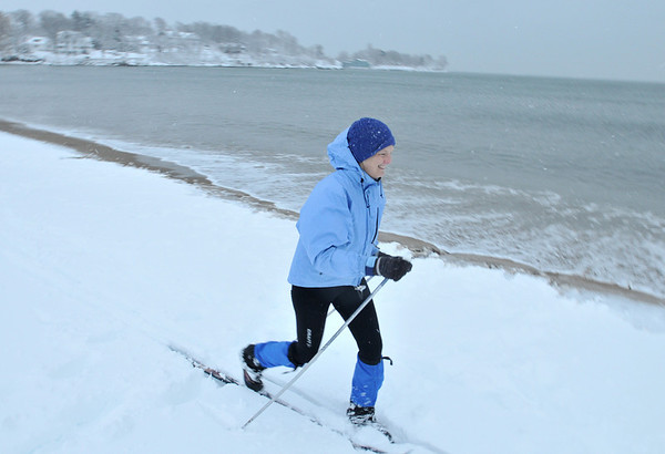 Beverly: Jennifer Pearson of Beverly said she always wanted to ski along the ocean as she slid by along Dane Street Beach.  photo by Mark Teiwes  / Salem News