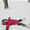 Salem: 4-year-old Sadie Engelhardt makes a snow angel in the Salem Common during the snow storm.  photo by Mark Teiwes / Salem News