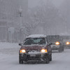 Cars make their way through the wind driven snow on Maple Street, Danvers Wednesday morning.<br /> Photo by Ken Yuszkus/Salem News, Wednesday, January 13, 2011.