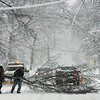 Beverly: Two motorists stop to remove this large tree branch that , was across Brimball Avenue, early Wednesday morning.Photo by Mark Lorenz/Salem News