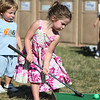 Danvers Family Festival: Maggie Burridge, 4, of Georgetown tries to putt a mini golf ball while her brother Jake, 2 watches and waits for his turn. Photo by David Le/Salem News