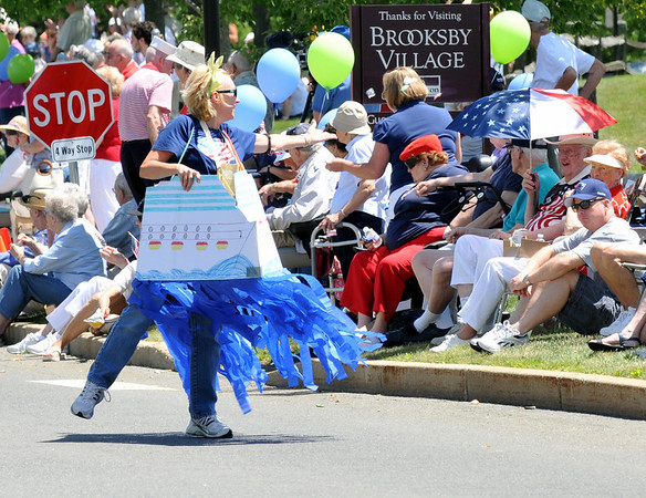 Kim Whitworth, the Brooksby Village trip coordinator, is dressed in a boat costume and tosses candy to residents during the parade. Photo by Mark Teiwes / Salem News