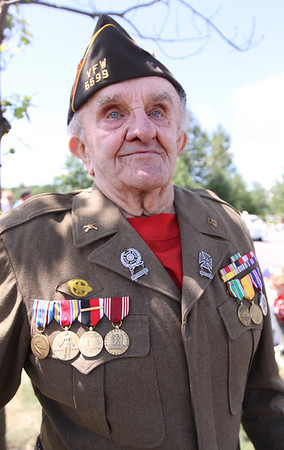 WWII Veteran Frank Acinapura watches the 4th of July parade at Brooksby Village in Peabody. Acinapura was a technical sergeant with the 635th AAA Anti-Aircraft Battalion in the European Theatre of WWII. He served from 1940 until 1945 before being honorably discharged, and won various medals for his service to the United States. Photo by Cole Margen/ Salem News.