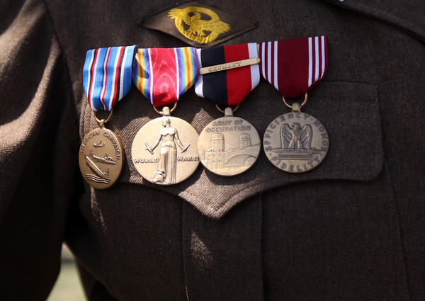 Frank Acinapura, a WWII veteran, proudly  displays his medals at the 4th of July Parade at Brooksby Village in Peabody on Friday. Acinapura was a recpient of the American Defense Service Medal, Good Conduct Medal, and The European-African-Middle Eastern Campaign Medal. Photo by Cole Margen/ Salem News