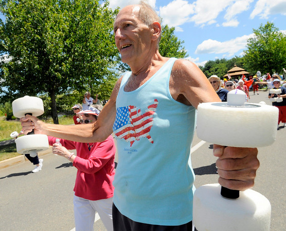 John Wroblewski does calisthenics while parading with the health club for Brooksby Village residents. Photo by Mark Teiwes / Salem News