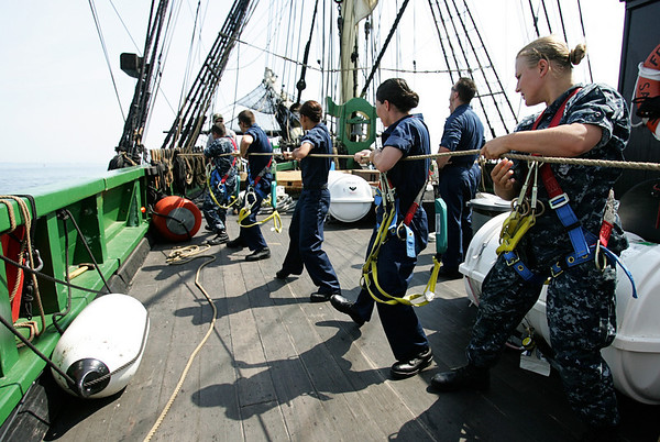 CS3 Jamie Lee Symes, far right, along with fellow naval officers work the sails while aboard the Friendship out at sea Tuesday. These are sailors who will work aboard the USS Constitution. They have been doing dry dock training since May and have been out to sea with the Friendship over the past three days. Photo by Deborah Parker/July 14, 2010