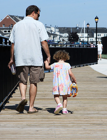 Sean and Lindsey Keough, of Salem enjoy walking along the recently completed Harborwalk in downtown Salem on Thursday afternoon. Photo by David Le/Salem News
