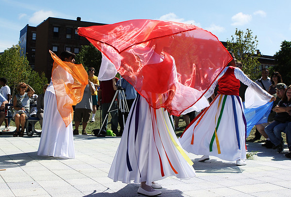 Members of the Bridges of Glory Dance Ministry perform a dance at the opening of the Harborwalk in downtown Salem on Thursday afternoon. The Harborwalk runs along the South River basin from Congress Street to Layfayette Street. Photo by David Le/Salem News