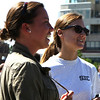 Emily Gardiner, left of Swampscott, and Katie Morgan, of Salem watch the opening ceremonies for the recently completed Harborwalk in downtown Salem on Thursday afternoon. Photo by David Le/Salem News