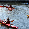 A small group of kayakers decided to stay cool and attend the opening ceremonies for the Harborwalk in style as they sat in the South River in downtown Salem, listening to the speeches and performances. Photo by David Le/Salem News