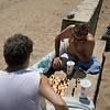 Edward Nudelman, left, and Thayer White play chess on Dane Street Beach in Beverly on Tuesday. Photo by Mary Catherine Adams/Salem News<br /> , Edward Nudelman, left, and Thayer White play chess on Dane Street Beach in Beverly on Tuesday. Photo by Mary Catherine Adams/Salem News