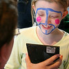Salem: Satya Hoff, a third-grader at Saltonstall School, has a peace sign painted on her face by Donna Curley during the school's annual Earth Day festivities. Photo by Mary Catherine Adams/Salem News
