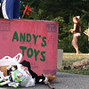 """Danvers: Props from a """"Toy Story"""" themed float sit on the sidewalk, waiting to be collected, as parade participants walk to the awards ceremony in Plains Park after the end of the Danvers Recreation Summer Playground Program Playground Parade. Photo by Mary Catherine Adams/Salem News.<br /> , Danvers: Props from a """"Toy Story"""" themed float sit on the sidewalk, waiting to be collected, as parade participants walk to the awards ceremony in Plains Park after the end of the Danvers Recreation Summer Playground Program Playground Parade. Photo by Mary Catherine Adams/Salem News."""