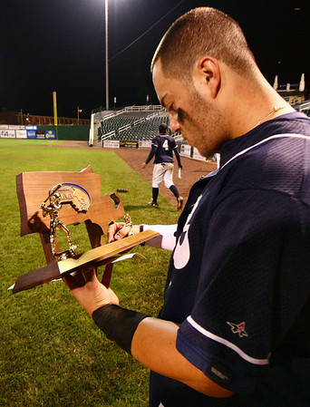 Lowell: Alex Markakis, captain of the St. John's Prep Eagles, admires the championship trophy after winning the final game against Lowell yesterday. Photo by Mary Catherine Adams/Salem News.