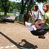 Peabody: Bella Sylvanowicz, 5, at left, swings on the tire swing with her cousins, Natalie Sylvanowicz and Natalie's sister, Ashley, both 9, at Ross Memorial Park in Peabody during their first week of summer vacation. Photo by Mary Catherine Adams/Salem News