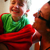 """Peabody: Hunter Jorgenson, 5, laughs as his mother, Tracey, coaxes him out of hiding behind his blanket. The younger Jorgenson appeared in the movie """"Knight and Day"""" with Tom Cruise. Photo by Mary Catherine Adams/Salem News"""