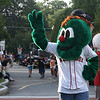 Danvers: Sam Ciruolo, 9, dressed as Wally, the Green Monster, waves to the crowd along the parade route during the Danvers Recreation Summer Playground Program Playground Parade. Photo by Mary Catherine Adams/Salem News.<br /> <br /> <br /> , Danvers: Sam Ciruolo, 9, dressed as Wally, the Green Monster, waves to the crowd along the parade route during the Danvers Recreation Summer Playground Program Playground Parade. Photo by Mary Catherine Adams/Salem News.